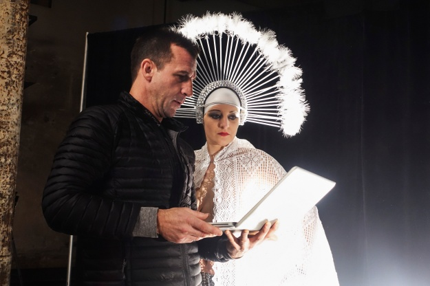 1. Director Nick Brigden and performer Laurie the Fox watch a sequence from the movie Metropolis. 2. Laurie the Fox performs a dance similar to one performed in the movie. Photos by Josh Ferrell.