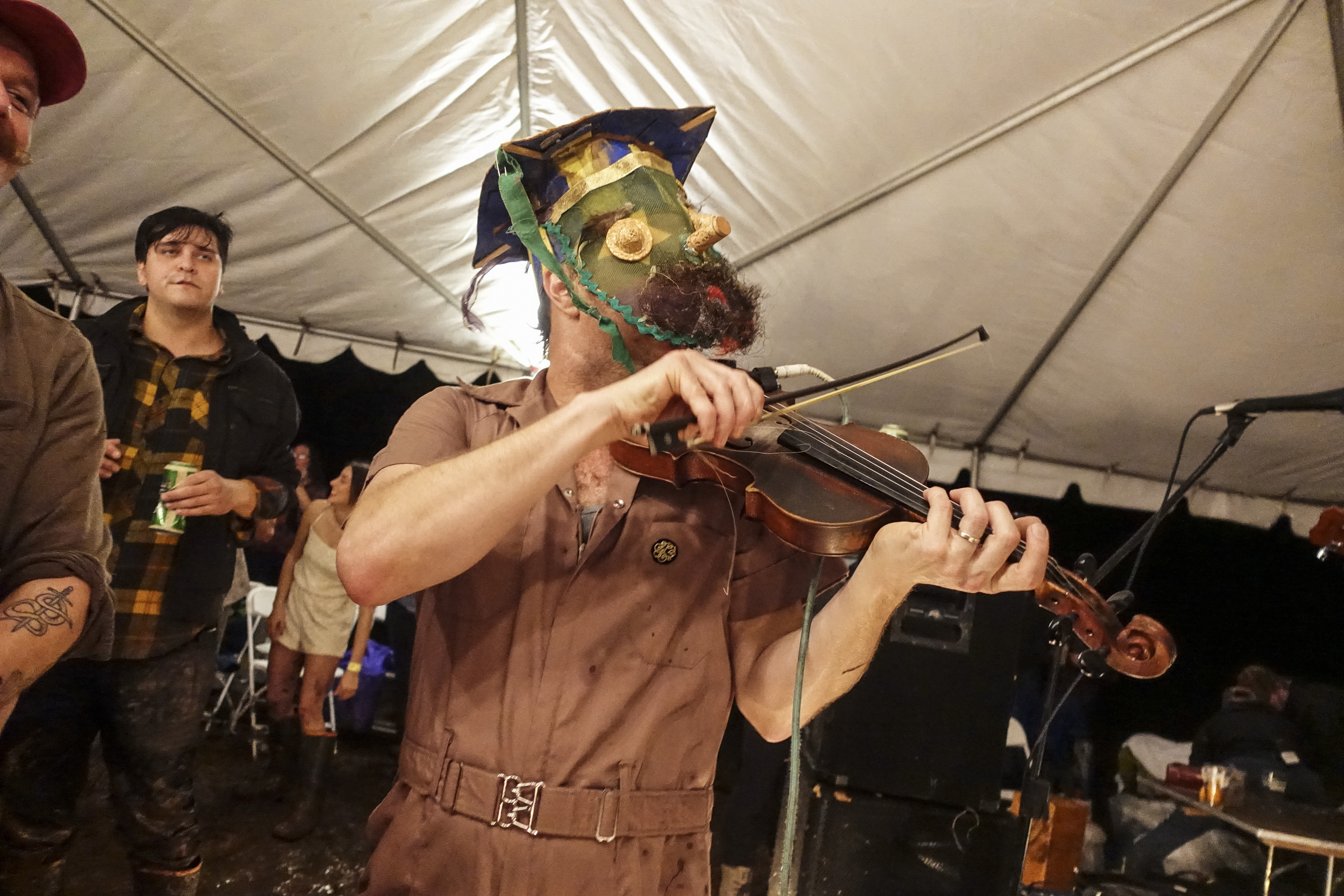 A man plays the fiddle during filming in Louisiana.