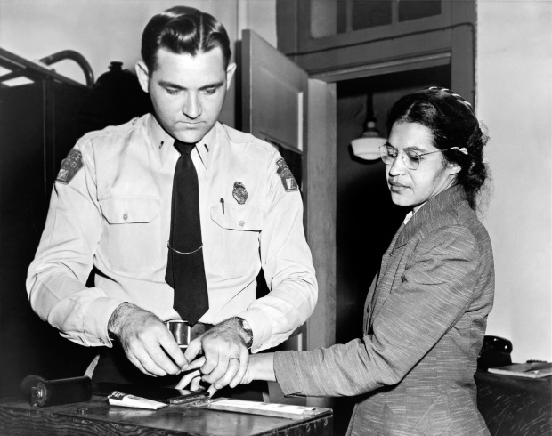 Rosa Parks being fingerprinted during her arrest. Underwood Archives via Getty Images.