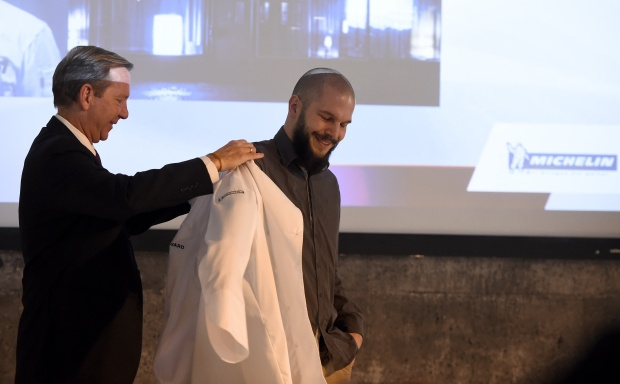 Chef Micha Schäfer receives his Michelin jacket. Photo by Tobais Schwarz/AFP/Getty Images.