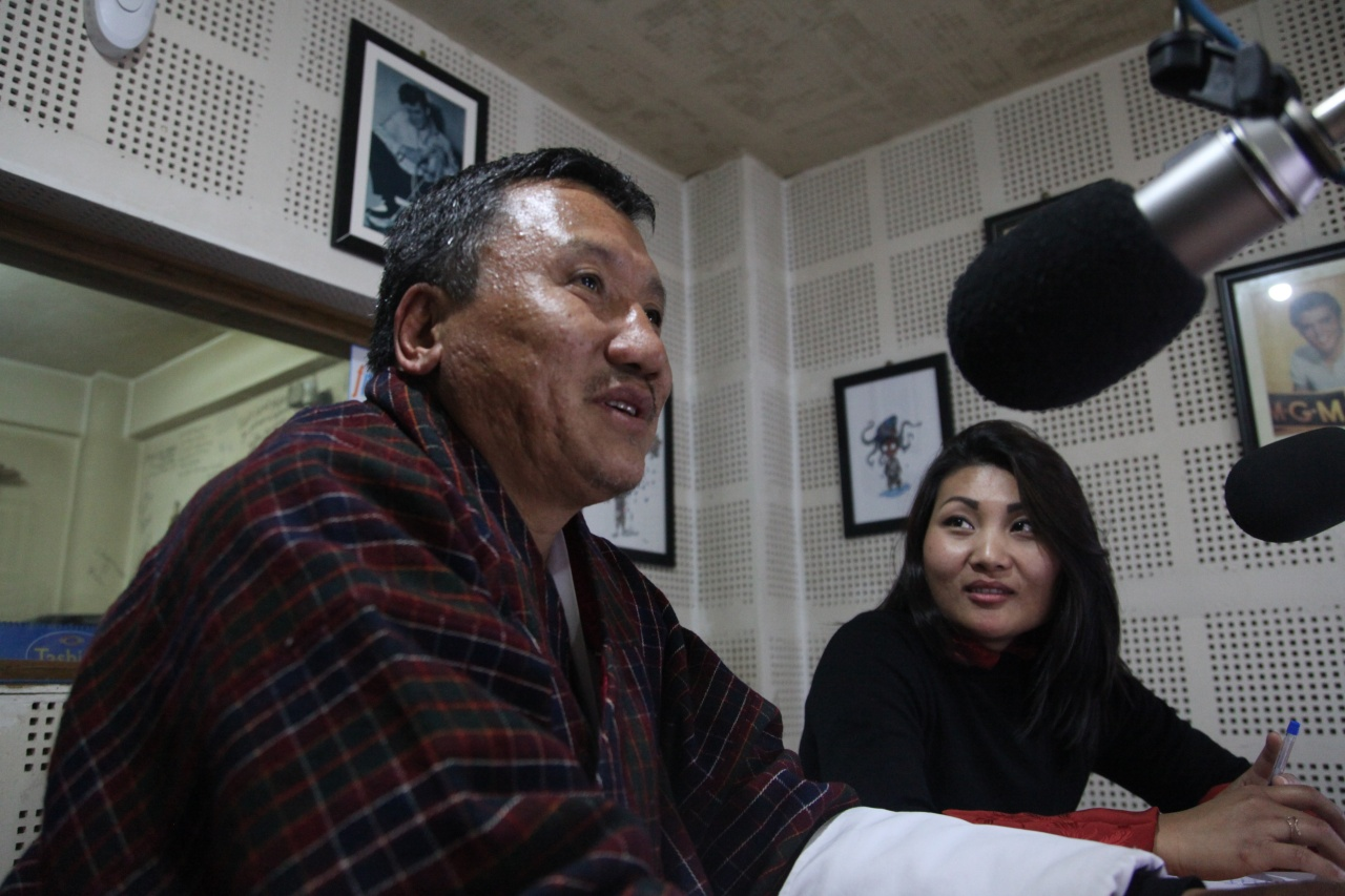 Dr. Chencho Dorji and Namgay Zam record an episode of Mind Over Matter Bhutan in the studio at Radio Valley in Thimphu.