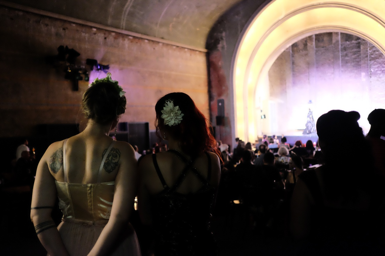 Two women watch a performance during the event.