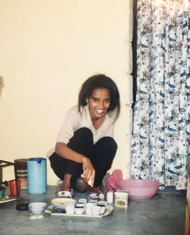 The author's aunt Ruth preparing coffee in Ethiopia.