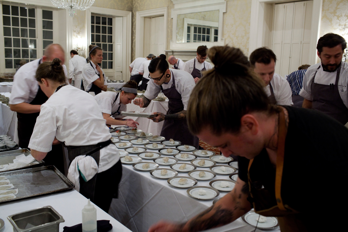 Plating madly upstairs at McCrady's before Thursday's dinner.