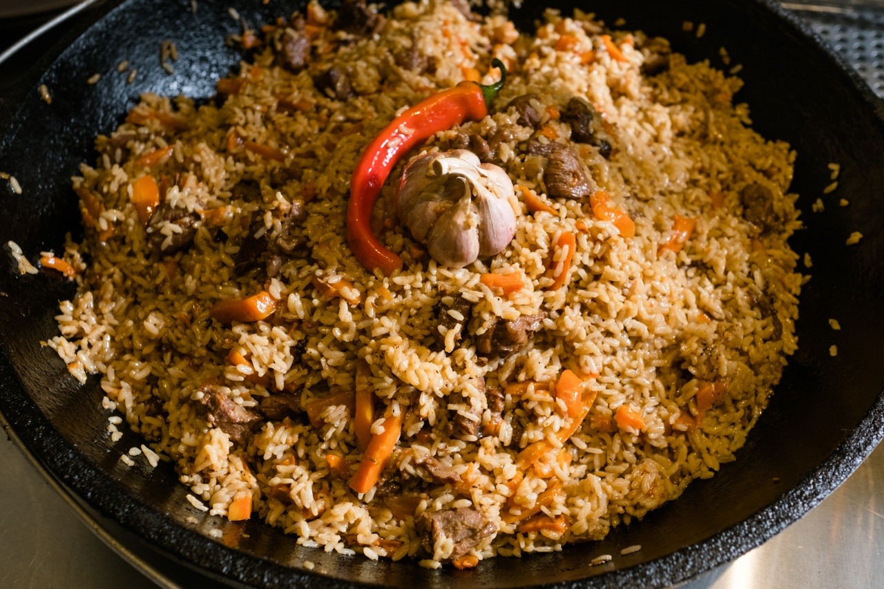 Plov—rice steamed in stock with meat and vegetables. Photo by Golubovystock/Shutterstock.