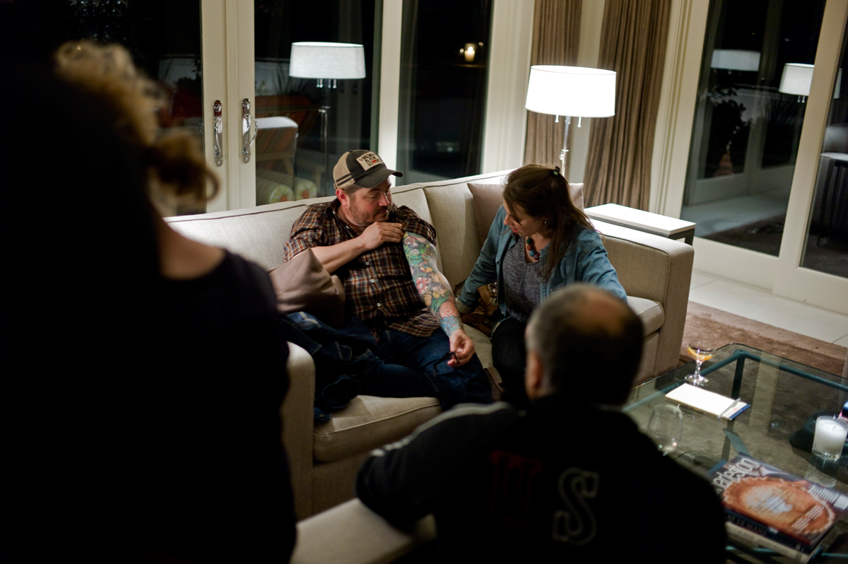 At a Cook it Raw party at local socialite and philathropist Terri Henning's house, Sean Brock tells the story of his tattoos.