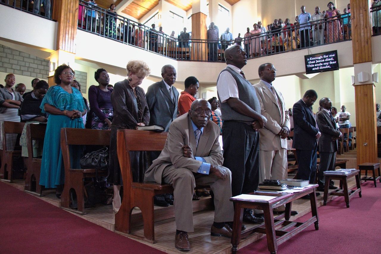 Churchgoers stand in prayer during a Sunday service at the Friends International Centre in Nairobi, Kenya.