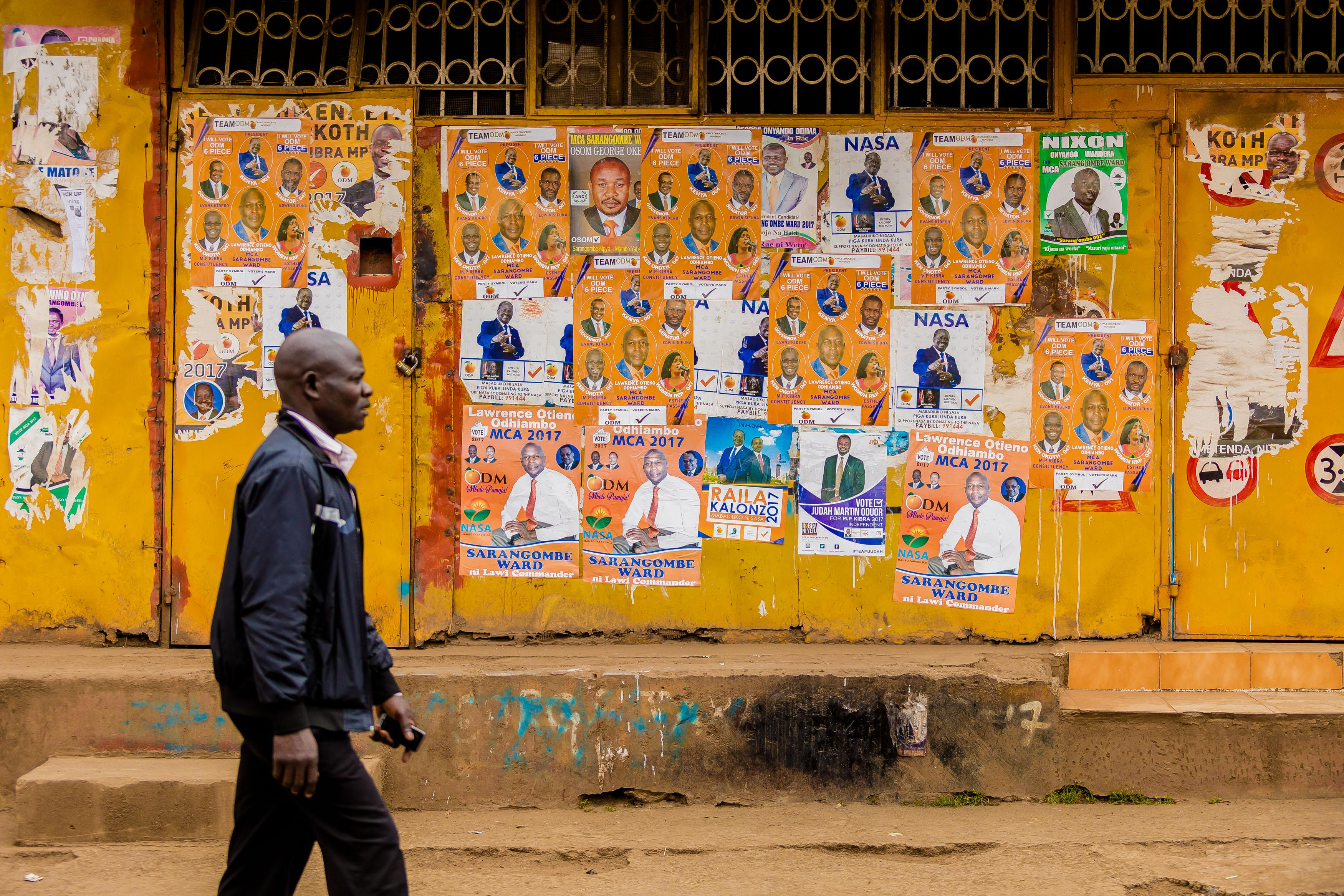 Posters for Kenya's 2017 general election. The election results were close between President Kenyatta and his main opponent, Raila Odinga, but there were many other candidates on the ballot.