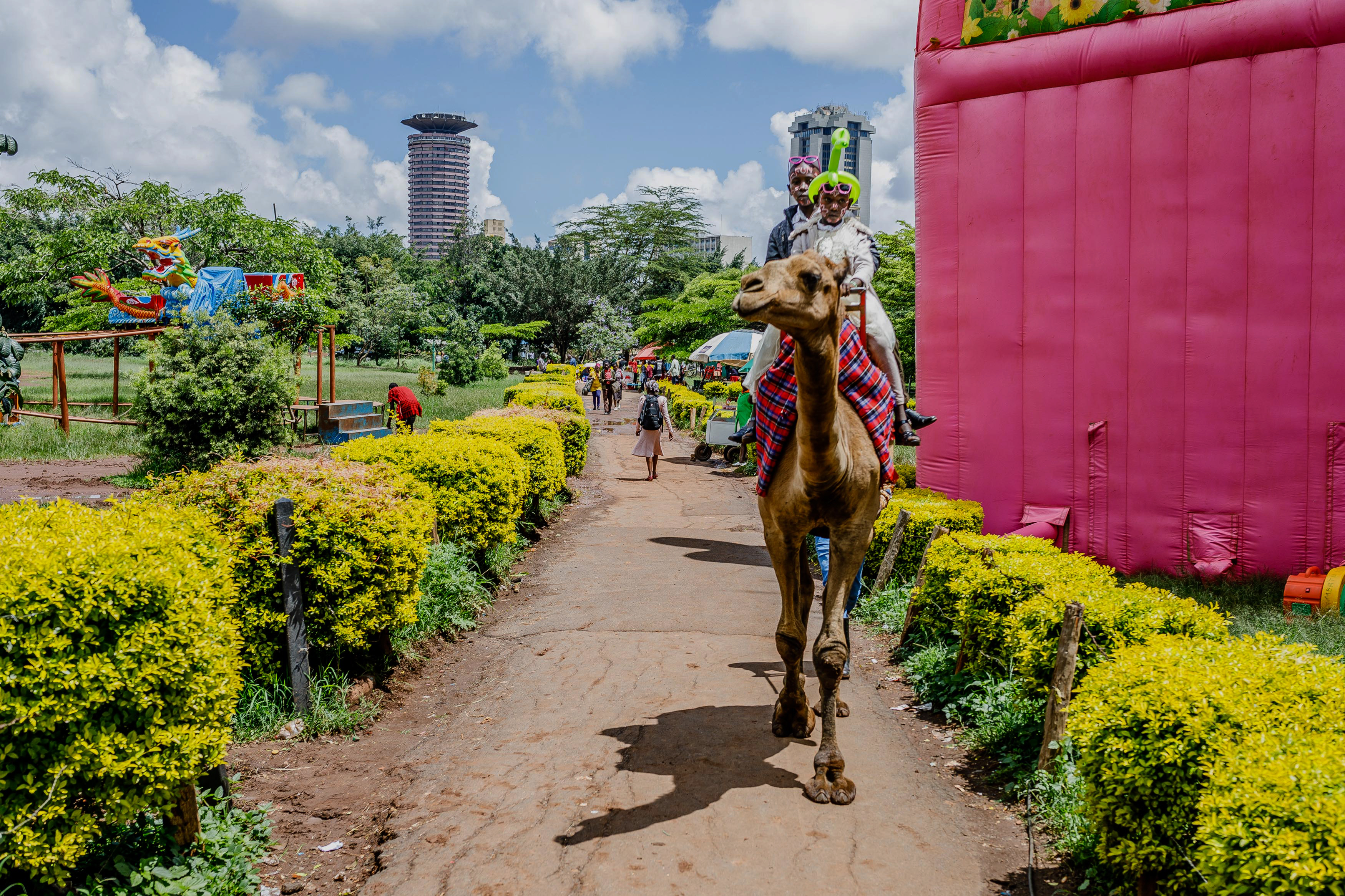 1. Out and about in Nairobi. 2. Camel riding at Uhuru Park.