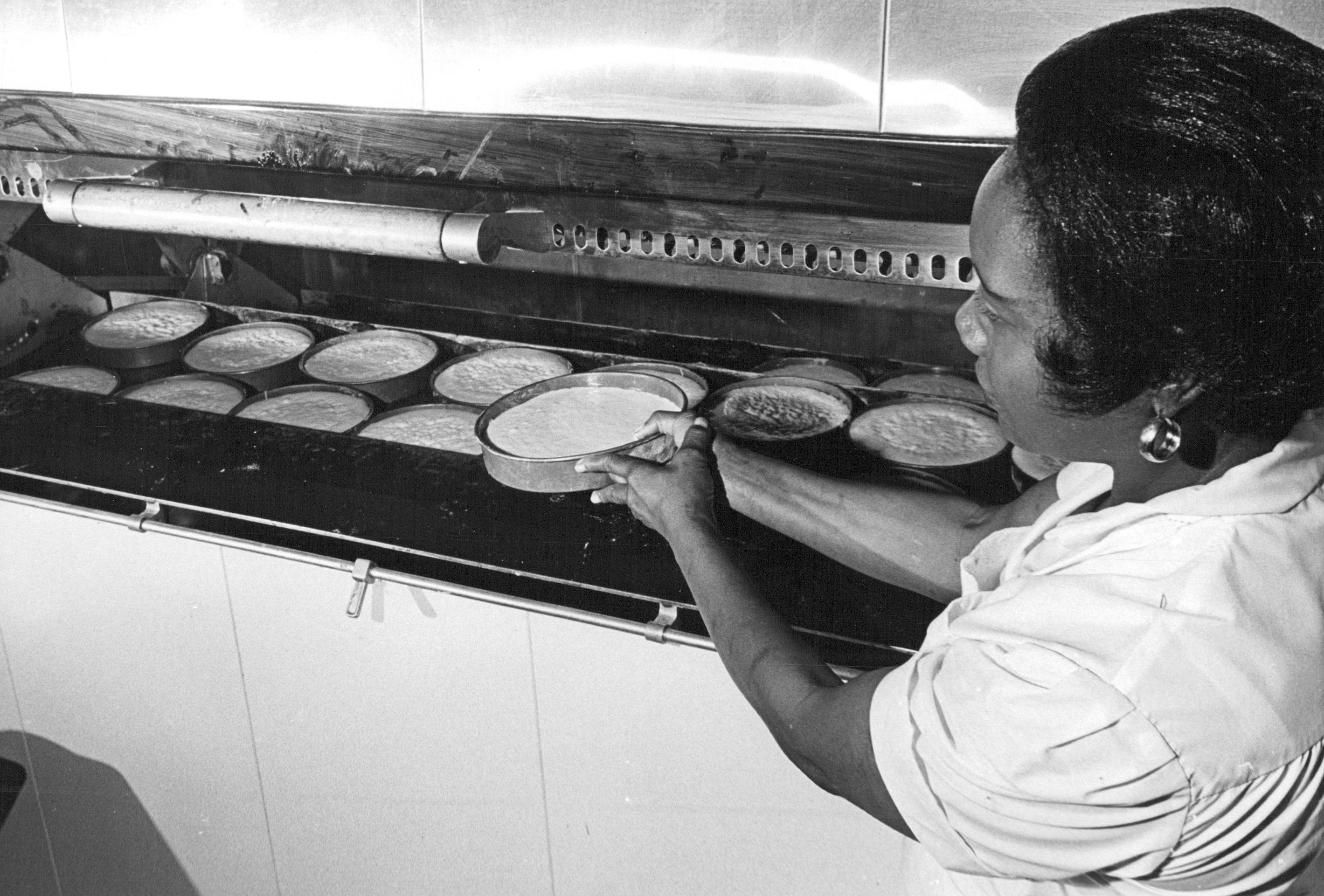 A woman bakes Boston cream pies in 1965. Photo By Dave Buresh / The Denver Post via Getty Images.