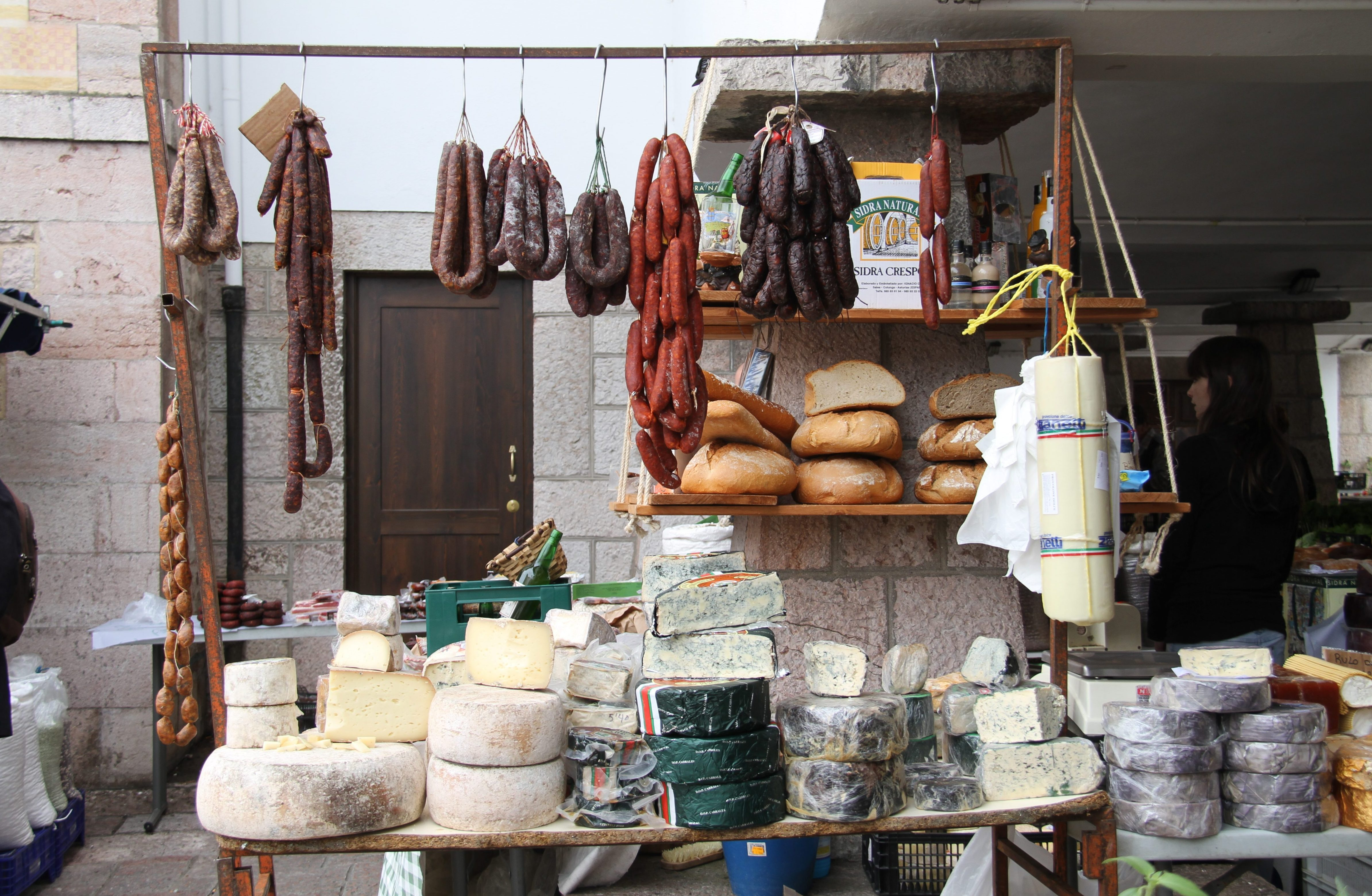1. Playa de Vega, near Ribadesella. 2. Asturian dairy dominance on display at the Cangas de Onís cheese market. Photos by Matt Goulding.