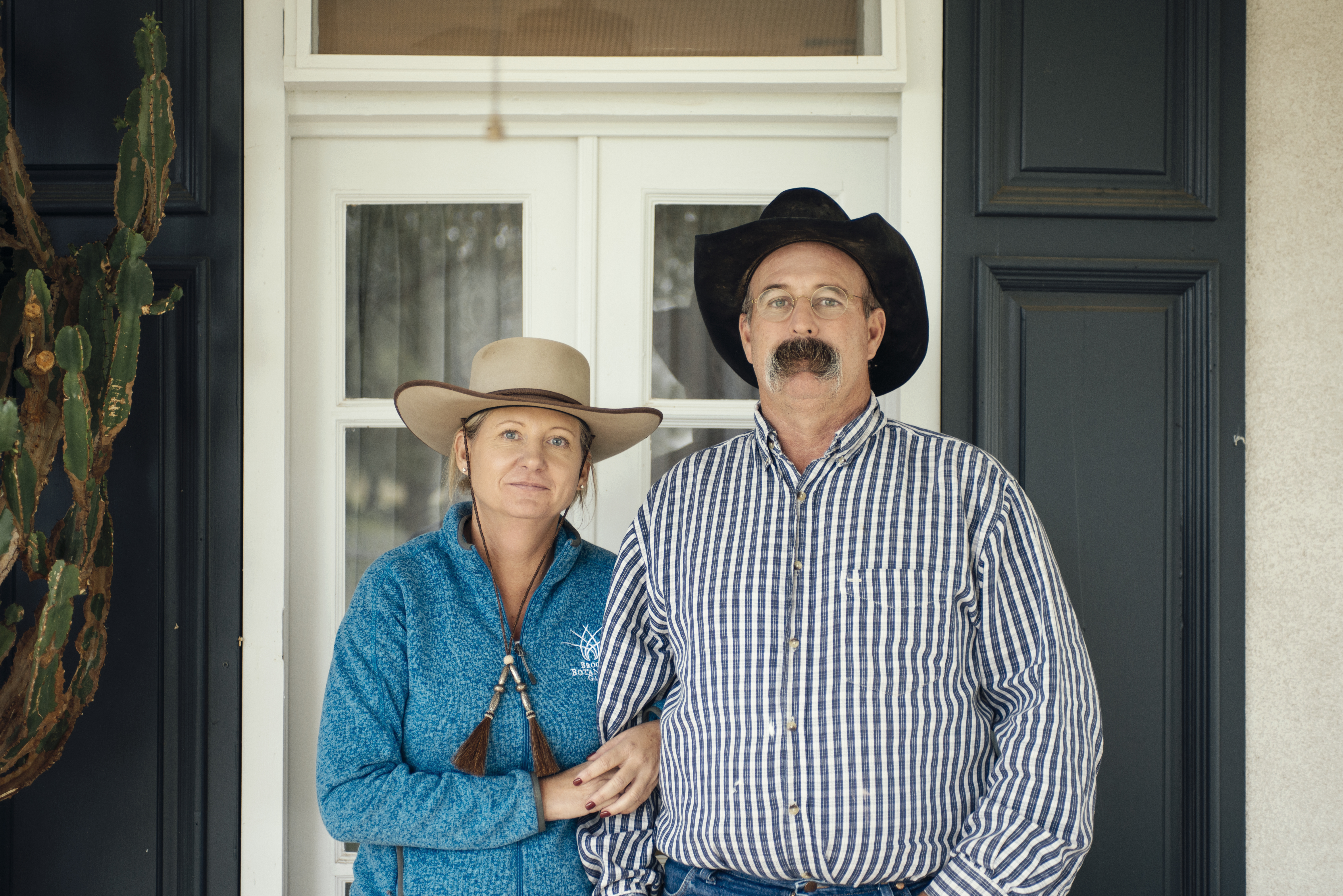 1. A picture of Scott McIvor's great grandfather. 2. Scott and Julie McIvor pose for a portrait in front of their ranch.
