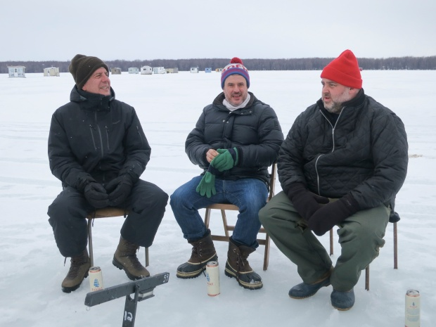 Bourdain ice fishing in Québec with Fred Morin and Dave McMillan. Photo by Josh Ferrell.