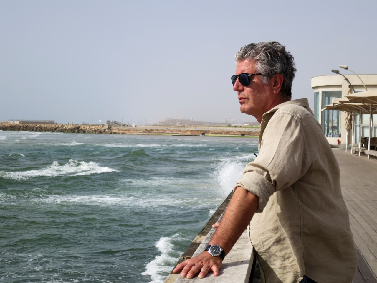 Bourdain on the coast of Tel Aviv, Israel.