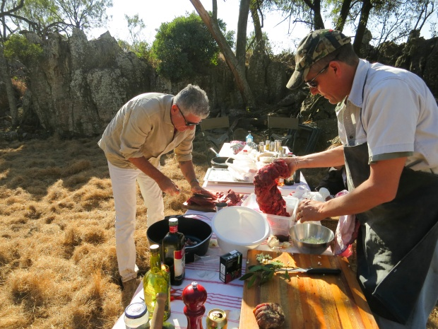 Bourdain helping cook dinner in South Africa.