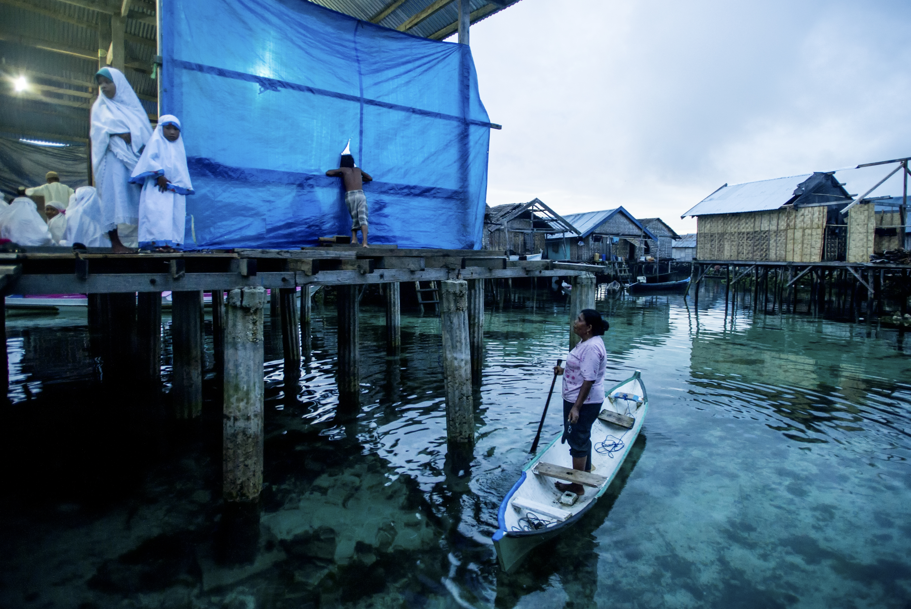 1. Though a majority of Bajau now live in stilt communities, they still build their mosques over the ocean. They practice a syncretic belief system that allows for a deep reverence for the ocean and the spirits that are said to inhabit it. 2. Night time prayers at a mosque on stilts over the ocean.