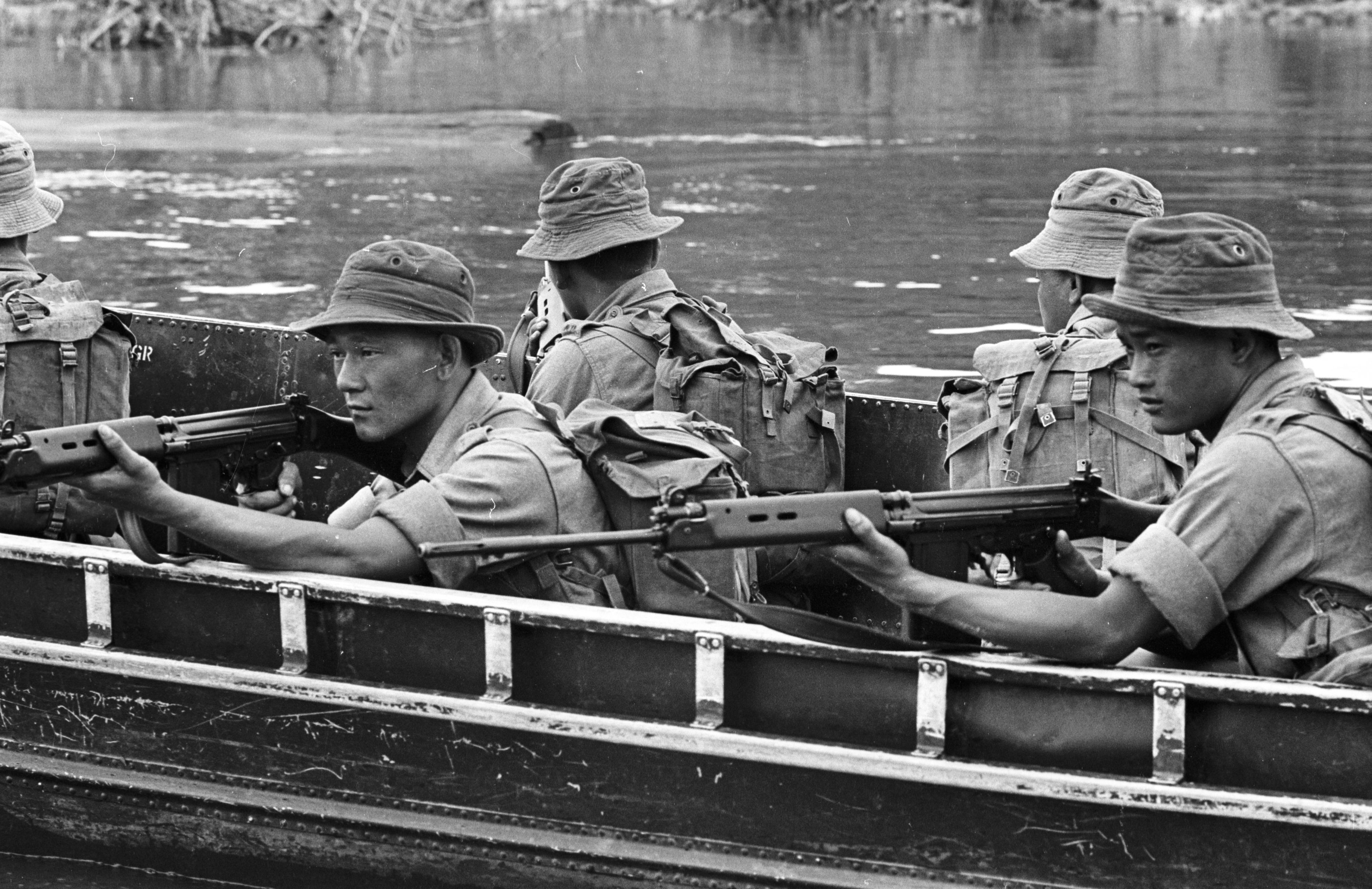 British soldiers on a boat in Borneo on March 11, 1965. Photo by Stan Meagher/Express via Getty Images.