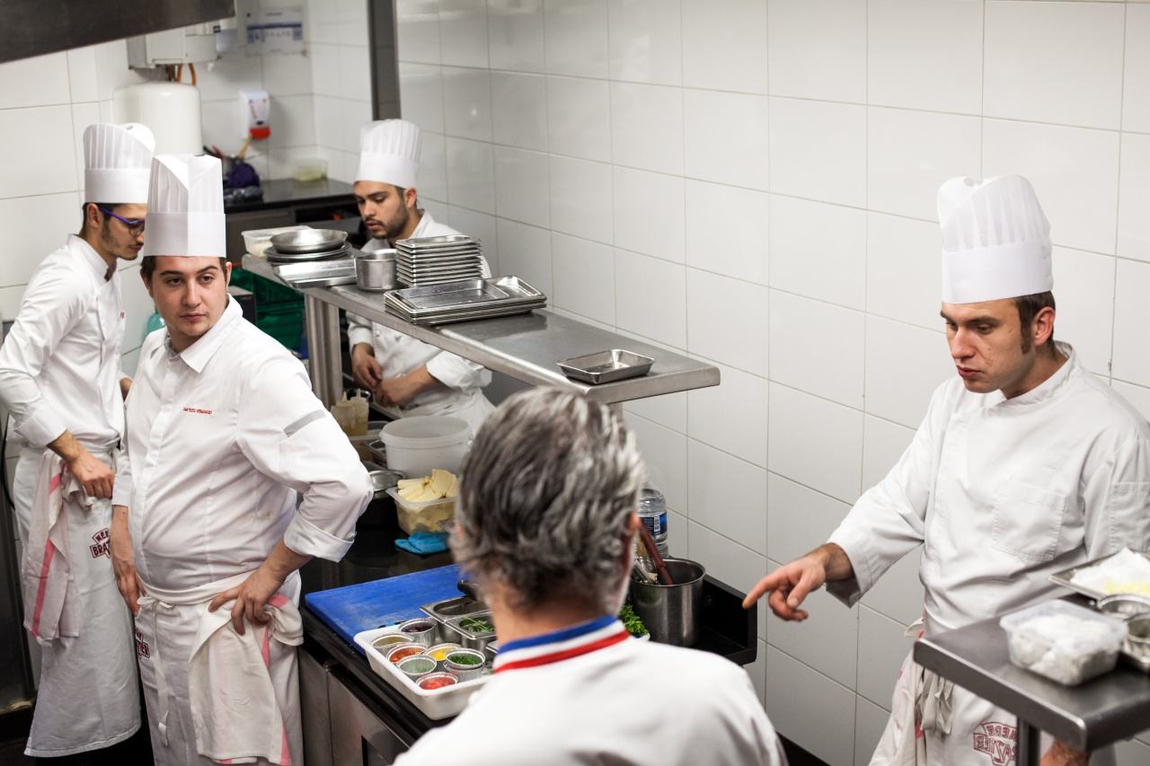 Chef Mathieu Viannay (center) and staff just before lunch service at La Mère Brazier.
