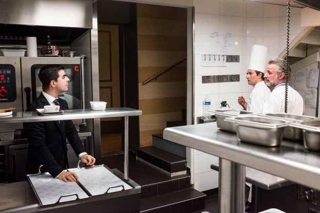 1. Final touches on the fond d'artichaut au foie gras. 2. Viannay talks to a waiter at the beginning of the shift.