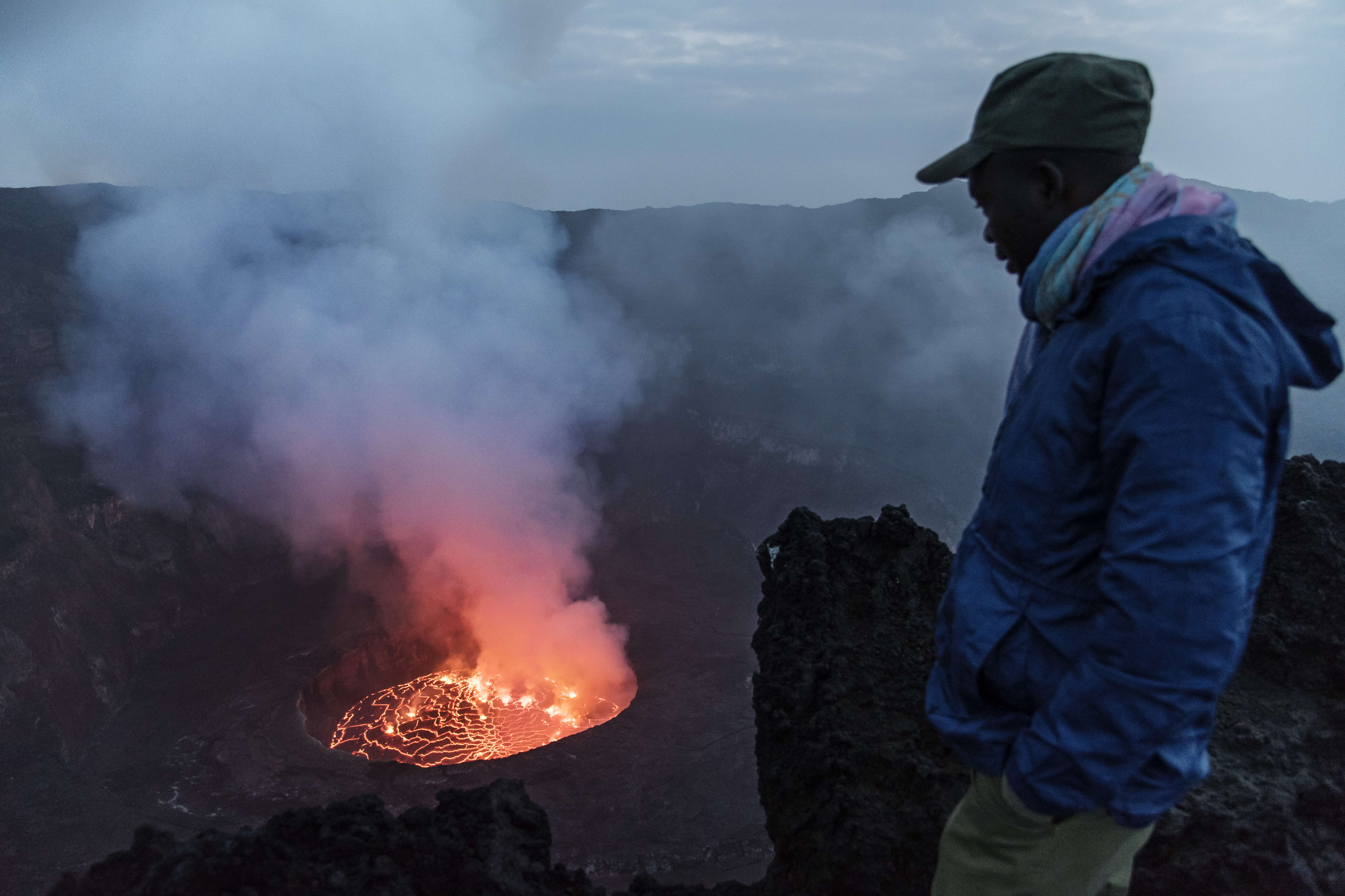 A ranger looks at the main crater of Mount Nyiragongo. Photo by Thierry Falise/LightRocket via Getty Images.