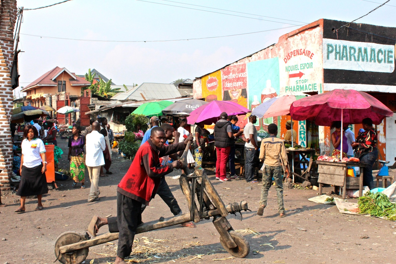 A man with a chukudu in a typical market in Goma.