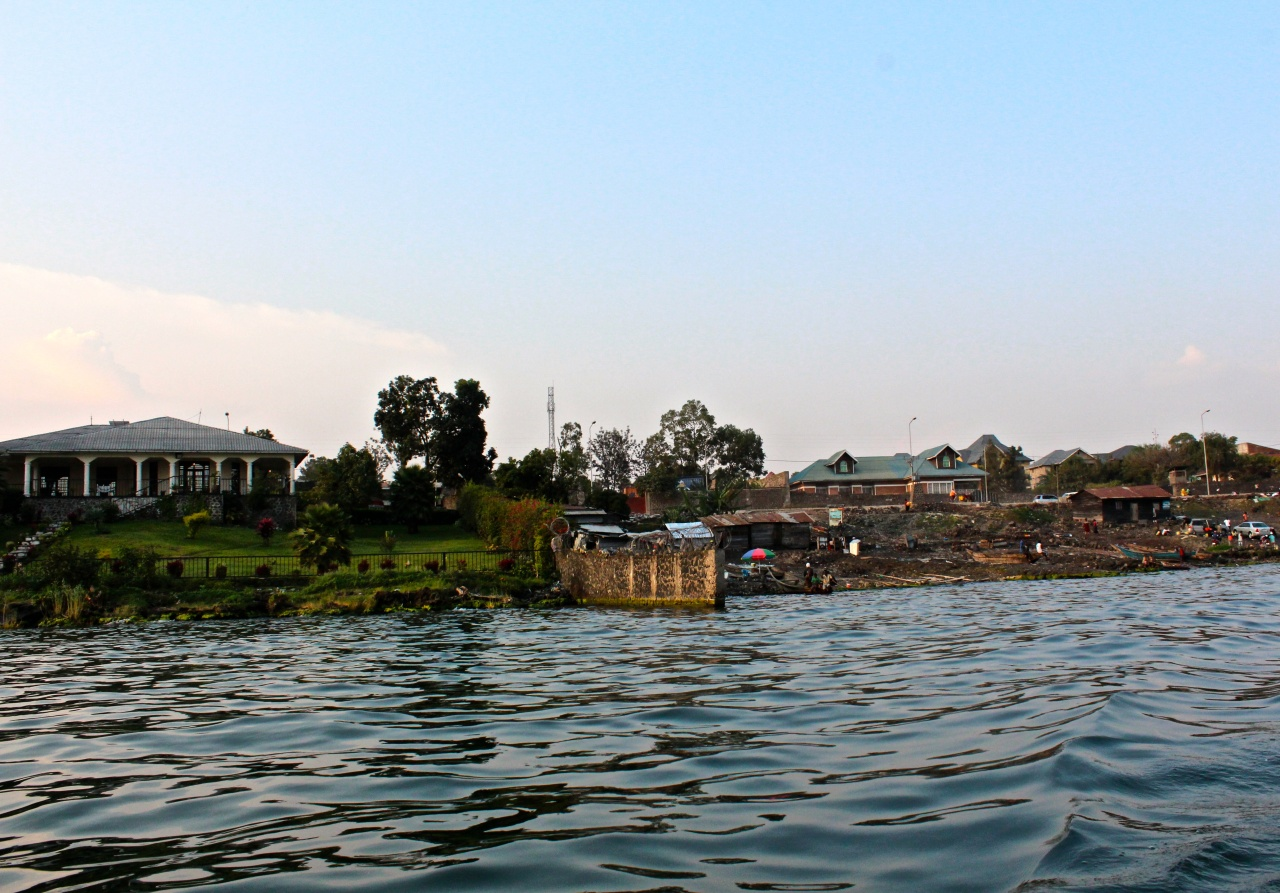 The view from Lake Kivu, where expensive villas dominate and pockets of space are left for people to access the lake for drinking water.