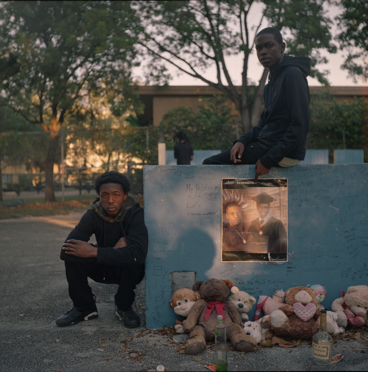 "Two young men pose next to a memorial for their friend Jedadiah ""Eggo"" Scatliffe, who was shot and killed at 18."