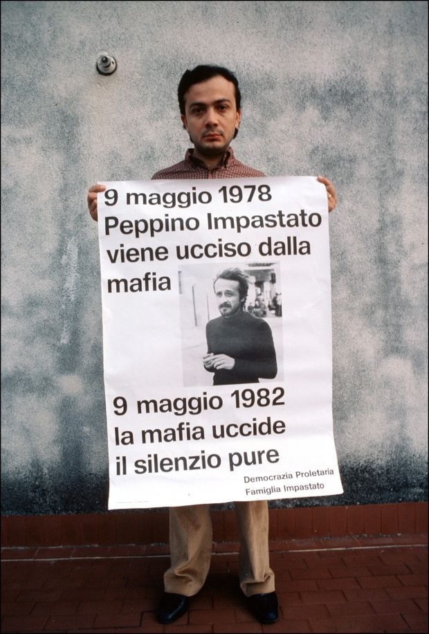 A man holds a sign for his brother, a victim of the mafia. Photo by Eric Vandeville/Gamma-Rapho via Getty Images