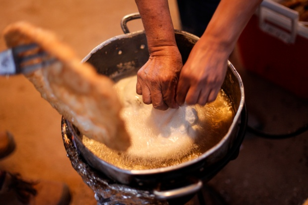 A woman making frybread. Photo by Danita Delimont via Getty Images.