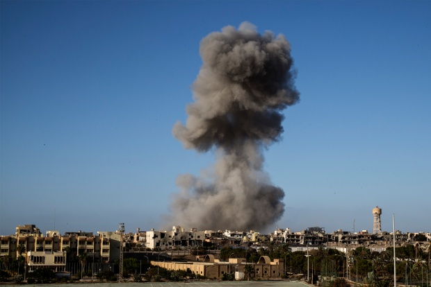 Smoke rise after an airstrike in Sirte during fighting with the Islamic State (IS) in September of 2016. Photo by Fabio Bucciarelli/AFP via Getty Images.