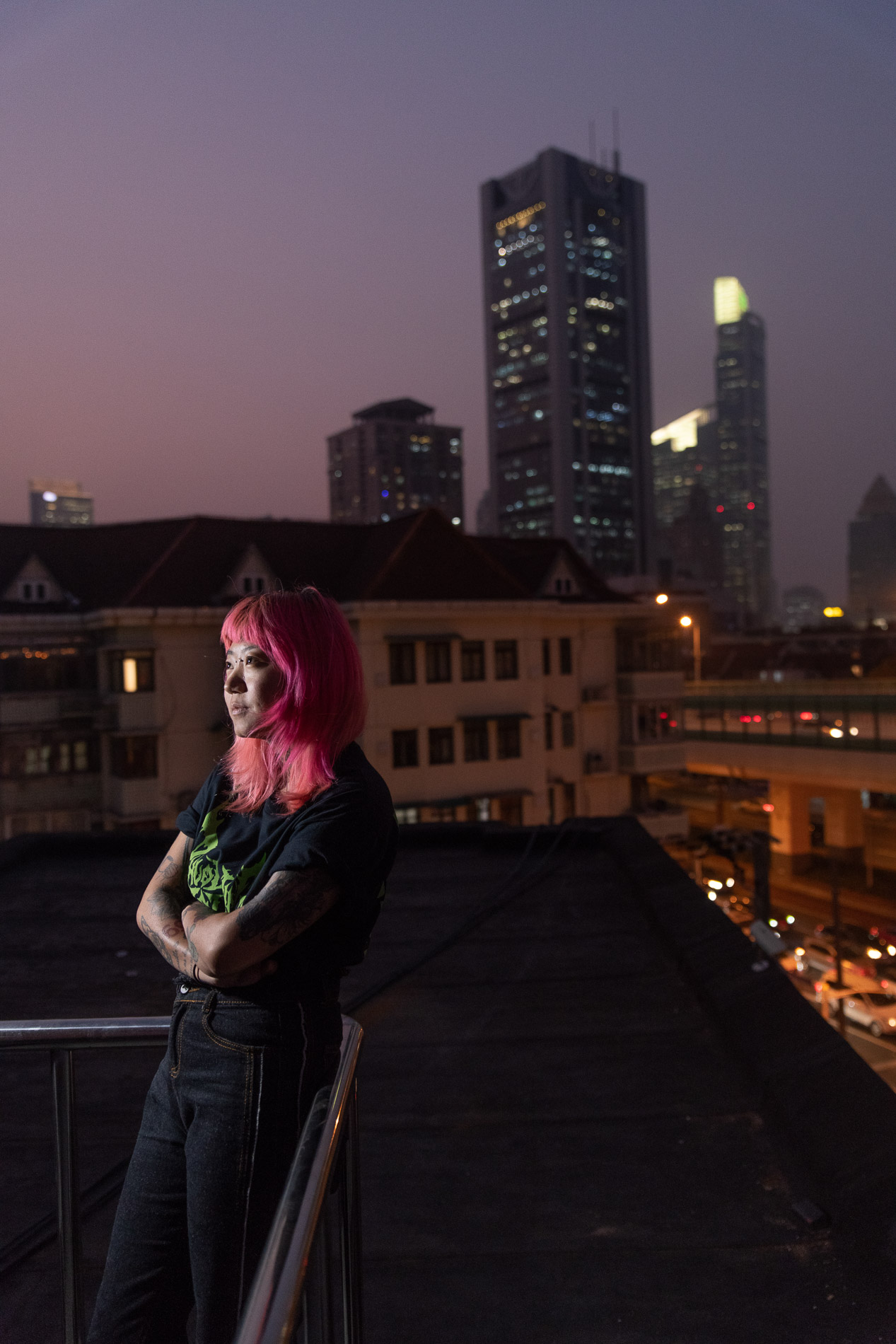 1. July, the manager of the Shanghai Tattoo, poses on the terrace of her studio. 2. Da Fei works at Shen Tattoo Studio and specializes in freehand anime.